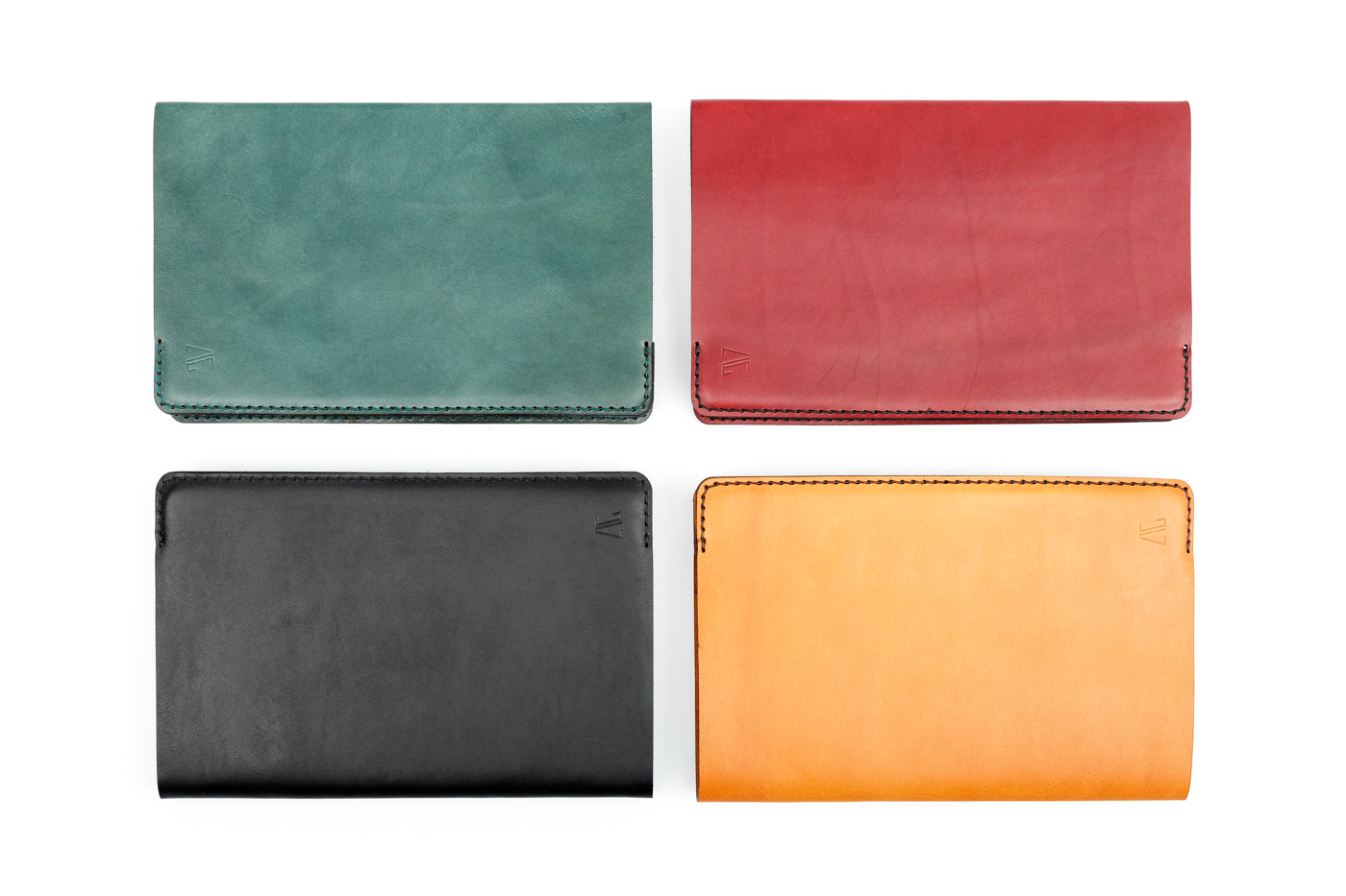 large leather notebooks in various colors