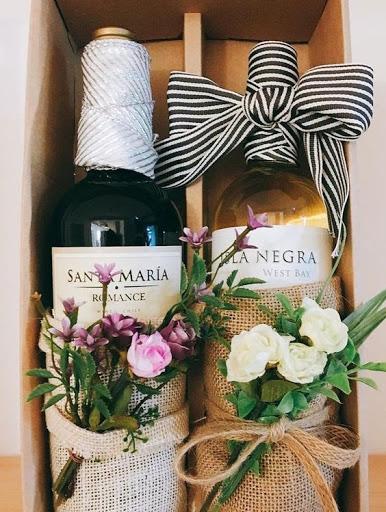 wine bottles and flowers arrangements
