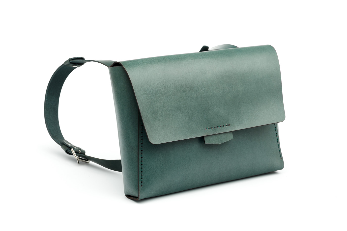 green leather bag and backpack